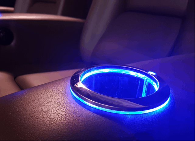 Glowing cupholder in custom theater seat arm