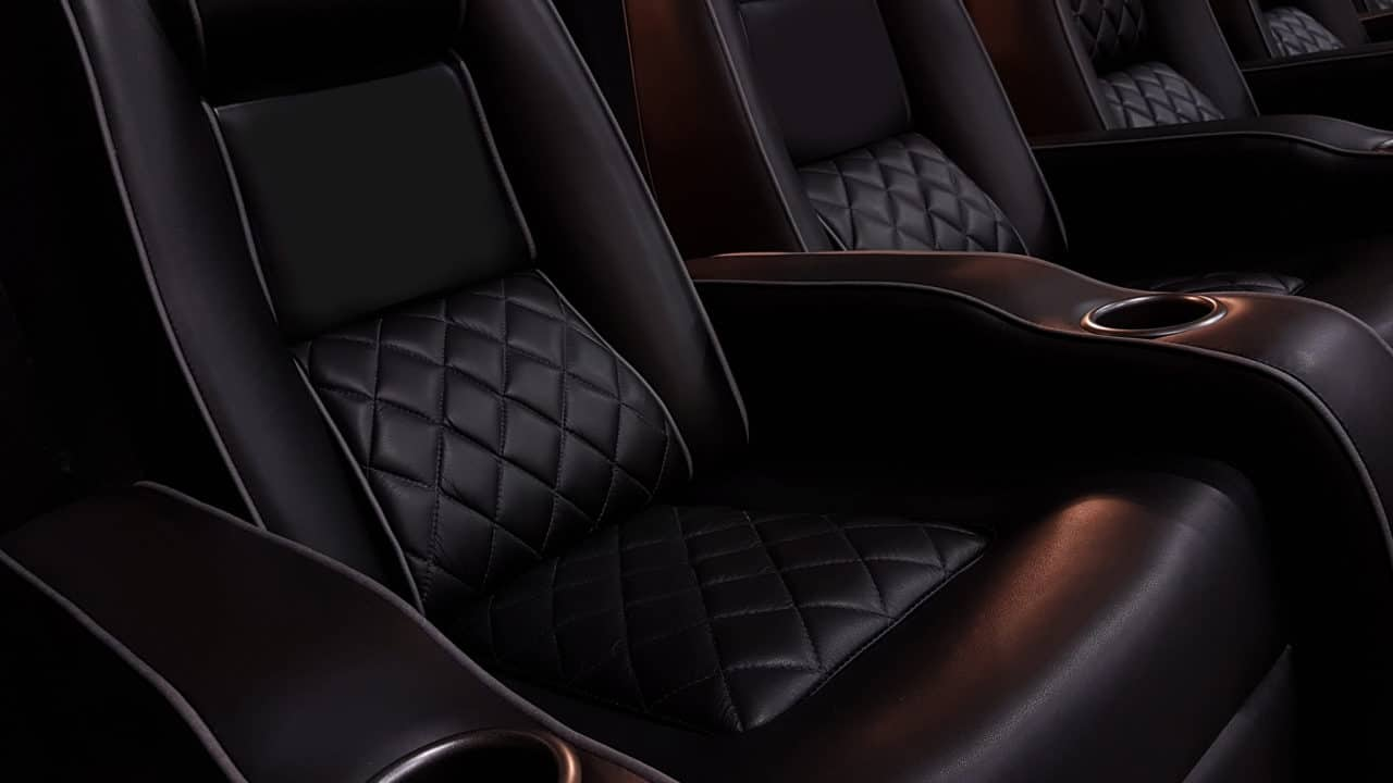 Black leather chairs with cupholders and cross pattern