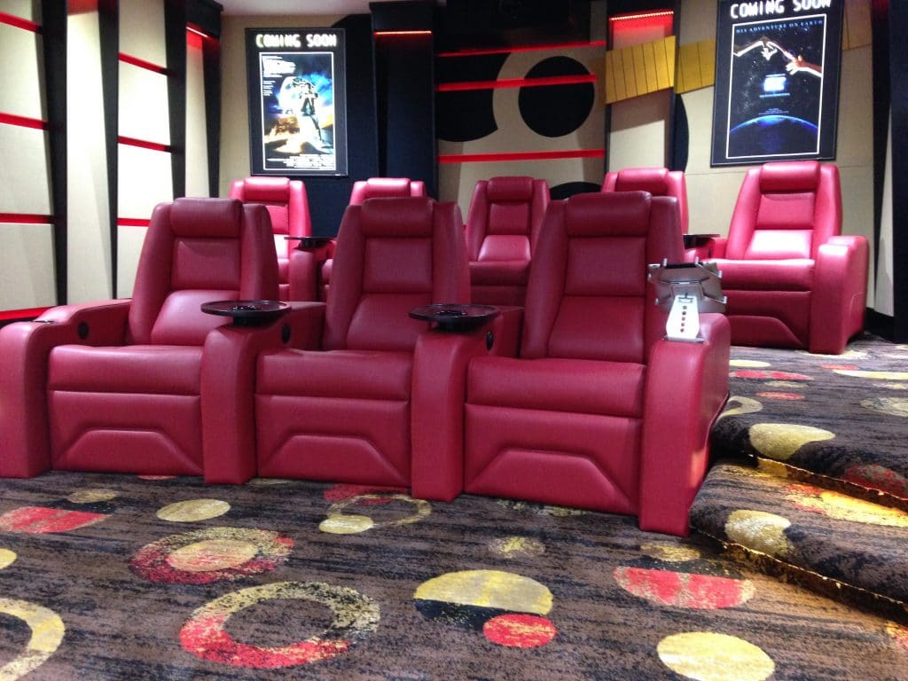 A guitar themed custom home cinema featuring luxury cinema chairs
