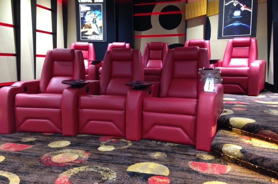 A guitar themed custom home cinema featuring luxury cinema chairs