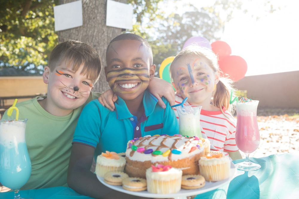 Kids enjoy mocktails and cake before a family-friendly home screening