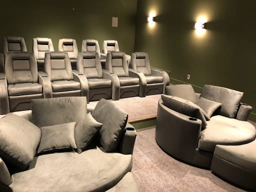 cuddle couches in a luxury home theater