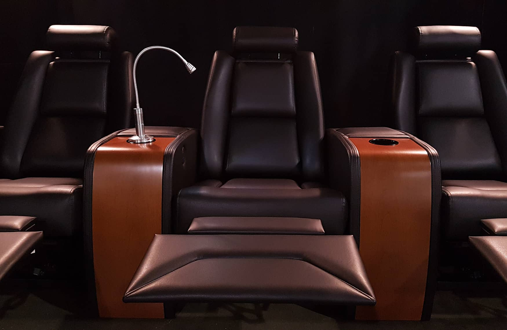 Black leather theatre recliner with light